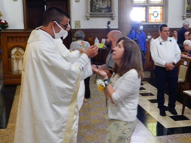 Fr. Lenny Gives Communion to his Mother