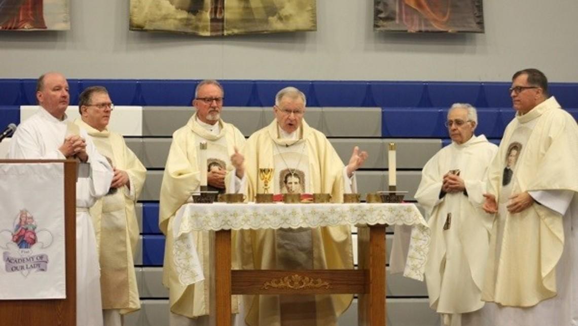 Abp Aymond celebrating Mass