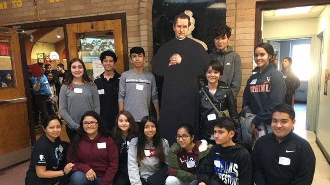 Group leader Elizabeth Sigua and her group of young people with Don Bosco
