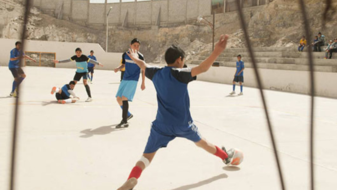 Kids playing soccer at a Salesian youth center in Ciudad Juarez