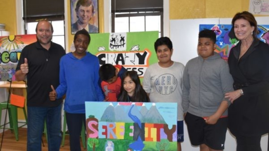 Daniel DeNapoli and Ann Heekin with some participants of The Mural Painting program.