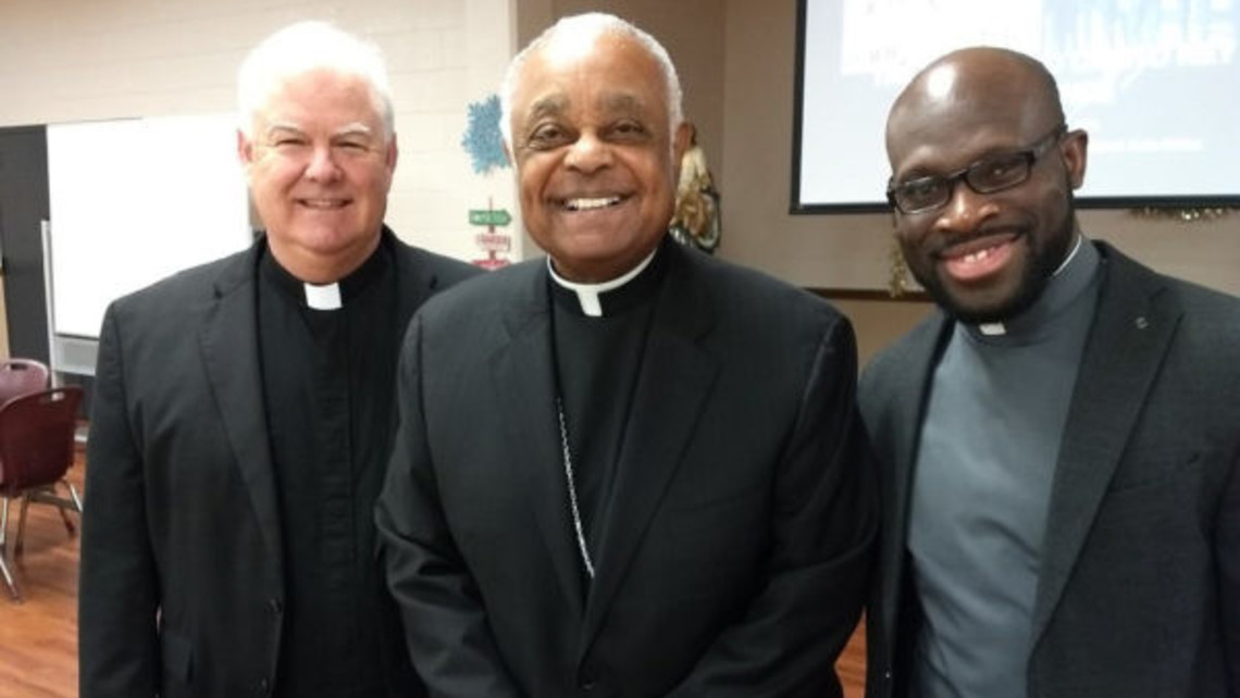 Fr. Michael Conway, Bishop Wilton Gregory, and Fr. Dieunel Victor